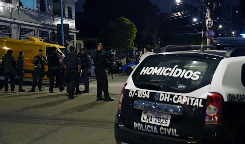 Rio's militarized police personnel guard the scene of a shooting