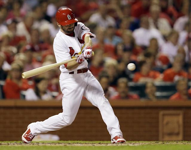St. Louis Cardinals' Shane Robinson hits an RBI single during the third inning of a baseball game against the Washington Nationals on Tuesday, Sept. 24, 2013, in St. Louis. (AP Photo/Jeff Roberson)