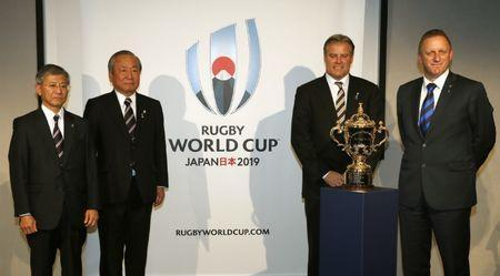 FILE PHOTO: Rugby Union - IRB Rugby World Cup 2019 Press Conference - The Queen Elizabeth II Conference Centre, Westminster, London - 27/10/15 (From L-R) Noriyuki Sakamoto, Chairman of The Japan Rugby Football Union, Akira Shimazu, CEO of Rugby World Cup 2019 Organising Comittee, Brett Gosper, Rugby World Cup Limited Managing Director and Alan Gilpin, Head of Rugby World Cup, pose or a photograph with The Webb Ellis Rugby World Cup Trophy Action Images via Reuters / Paul Childs Livepic