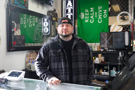 "Eric Catalano, an auto finance manager turned tattoo artist, specializes in the art of healing. The single father of three performs up to eight reconstructive medical tattoos for free each ""Wellness Wednesday"" in his small Illinois shop, drawing in nails on finger amputees, mocking up belly buttons after tummy tucks or fleshing out lips on a woman mauled by a dog. (Michael B. Thomas for KHN)"