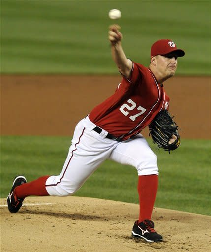 Washington Nationals' starting pitcher Jordan Zimmermann delivers pitch in the second inning to a Philadelphia Phillies batter during their baseball game at Nationals Park, Sunday, May 6, 2012, in Washington. (AP Photo/Richard Lipski)