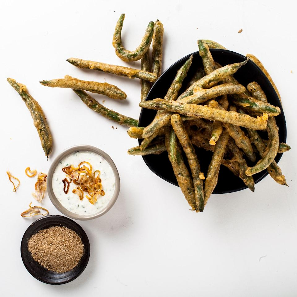 "A light batter and crunchy green beans will keep you from passing out in a food coma before the main course hits. <a href=""https://www.bonappetit.com/uncategorized/article/tempura-green-beans?mbid=synd_yahoo_rss"" rel=""nofollow noopener"" target=""_blank"" data-ylk=""slk:See article."" class=""link rapid-noclick-resp"">See article.</a>"