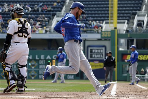 Chicago Cubs starting pitcher Travis Wood scores from second on am RBI single by Starlin Castro during the third inning of a baseball game against the Pittsburgh Pirates in Pittsburgh, Thursday, April 4, 2013. (AP Photo/Gene J. Puskar)