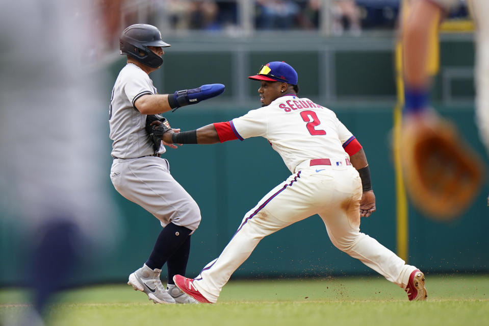 New York Yankees' Rougned Odor, left, is tagged out by Philadelphia Phillies second baseman Jean Segura after getting caught in a rundown on a fielder's choice by Gio Urshela during the seventh inning of a baseball game, Sunday, June 13, 2021, in Philadelphia. (AP Photo/Matt Slocum)