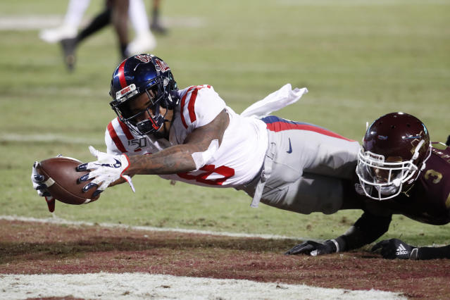 Mississippi wide receiver Elijah Moore (8) dives into the end zone with a 2-yard touchdown pass reception against Mississippi State during the second half of an NCAA college football game in Starkville, Miss., Thursday, Nov. 28, 2019. (AP Photo/Rogelio V. Solis)