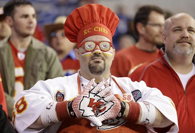 A Kansas City Chiefs fans watches during warm-ups before an NFL wild-card playoff football game against the Indianapolis Colts Saturday, Jan. 4, 2014, in Indianapolis. (AP Photo/Michael Conroy)