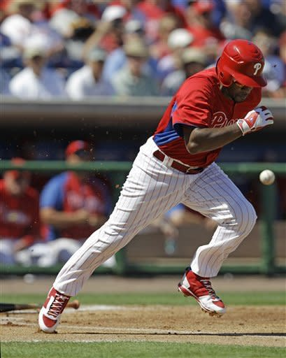 Philadelphia Phillies shortstop Jimmy Rollins tries to run out a groundout in the first inning of the Phillies spring training baseball game against the Pittsburgh Pirates at Brighthouse Field in Clearwater, Fla., Thursday, March 8, 2012. (AP Photo/Kathy Willens)