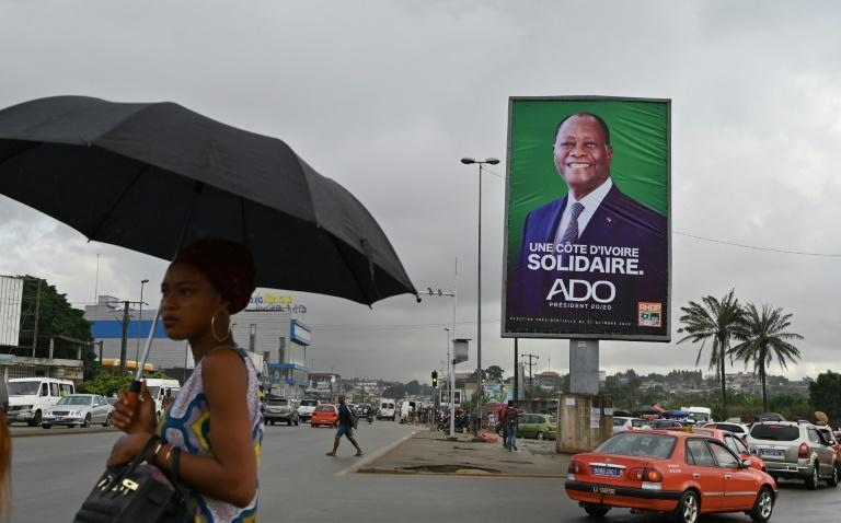 Ivory Coast's President Alassane Ouattara, seen here in a campaign poster, is running for a third term in defiance of a constitutional limit
