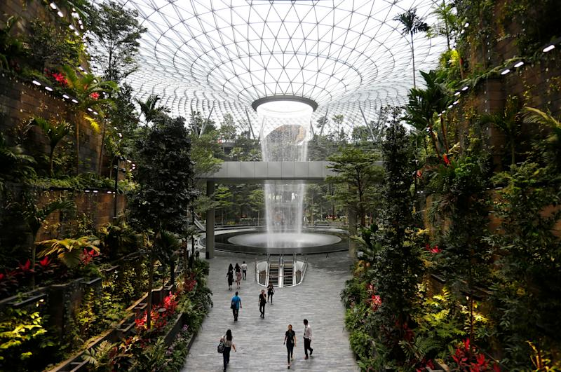 The 40-metre high Rain Vortex, which is the world's tallest indoor waterfall, is seen from inside Jewel Changi Airport in Singapore, April 11, 2019. REUTERS/Feline Lim TPX IMAGES OF THE DAY