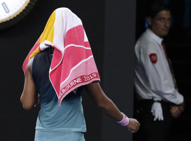 Japan's Naomi Osaka walks from the court after losing the second set to Petra Kvitova of the Czech Republic during the women's singles final at the Australian Open tennis championships in Melbourne, Australia, Saturday, Jan. 26, 2019. (AP Photo/Aaron Favila)