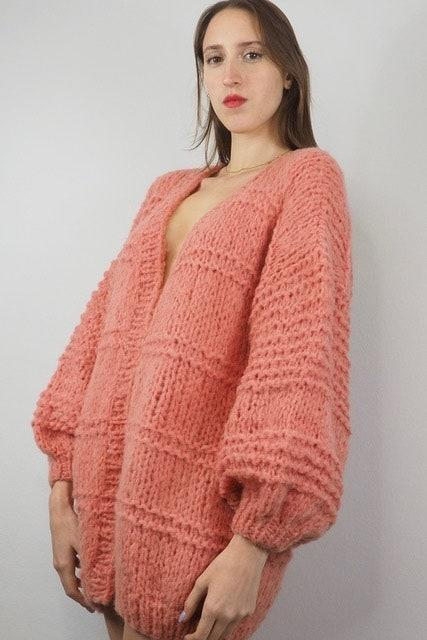 """<p>Experience the luxury of the most ethical comfort. Based in Barcelona, Michele & Hoven's timeless collections are committed to ethical fashion, creating exclusive pieces, hand-knitted with Alpaca wool. Their limited production line reflects the brand's sustainable values and their respect for our lands and traditions. <a href=""""https://www.micheleandhoven.com/we-are"""" rel=""""nofollow noopener"""" target=""""_blank"""" data-ylk=""""slk:micheleandhoven.com"""" class=""""link rapid-noclick-resp"""">micheleandhoven.com</a></p> <p><em>Follow them on Instagram</em> <a href=""""https://www.instagram.com/micheleandhoven/?hl=en"""" rel=""""nofollow noopener"""" target=""""_blank"""" data-ylk=""""slk:@micheleandhoven"""" class=""""link rapid-noclick-resp""""><em>@micheleandhoven</em></a></p>"""