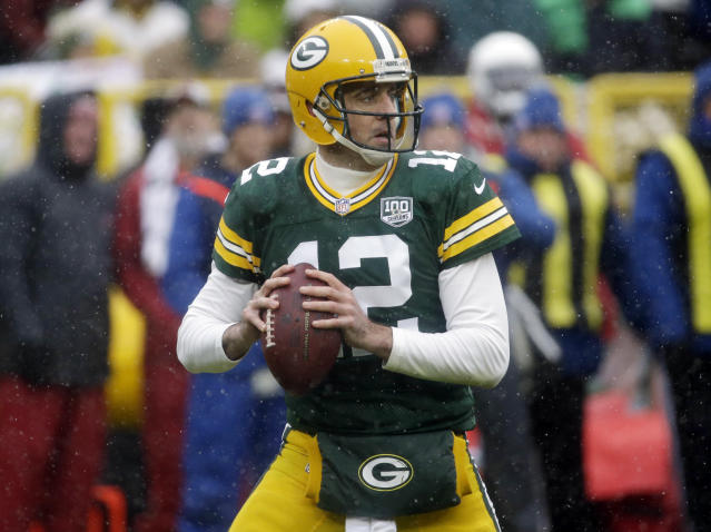 Green Bay Packers quarterback Aaron Rodgers looks to pass the ball during the first half of an NFL football game against the Arizona Cardinals, Sunday, Dec. 2, 2018, in Green Bay, Wis. (AP Photo/Mike Roemer)