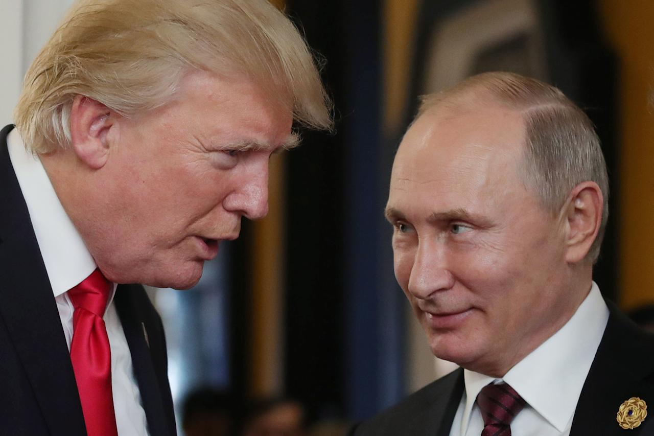 <p>President Donald Trump chats with Russia's President Vladimir Putin as they attend the APEC Economic Leaders' Meeting, part of the Asia-Pacific Economic Cooperation (APEC) leaders' summit in the central Vietnamese city of Danang on Nov. 11, 2017. (Photo: Mikhail Klimentyev/Sputnik/AFP/Getty Images) </p>
