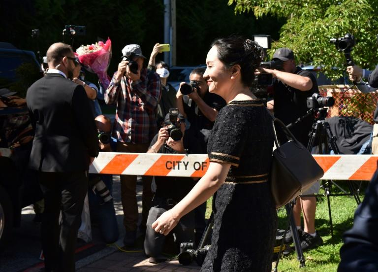 Defense lawyers for Chinese Huawei tech executive Meng Wanzhou, seen here leaving her Vancouver home for court in May, allege her arrest on a US extradition warrant was not lawful
