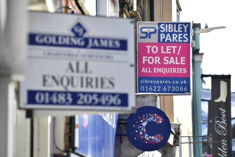 To Let signs are seen on shop units on the high street in Maidstone, southeast England, during the the continuation of Britain's third coronavirus lockdown that has closed all non-essential stores in an effort to suppress Covid-19 infections.