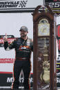 Josh Berry poses with the winners trophy as he celebrates winning the rain delayed NASCAR Xfinity Series auto race at Martinsville Speedway in Martinsville, Va., Sunday, April 11, 2021. (AP Photo/Steve Helber)