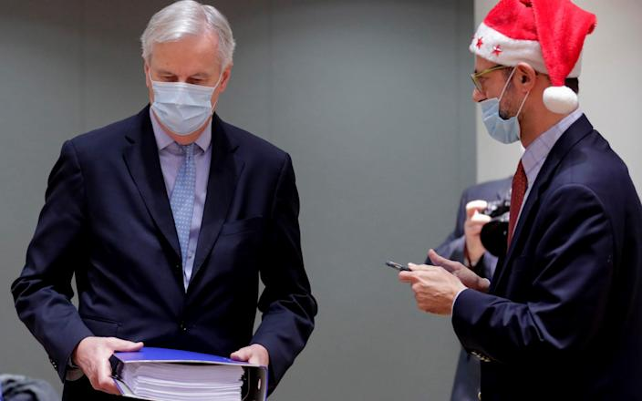 Michel Barnier, the EU's chief Brexit negotiator, and a colleague in festive garb - POOL EPA/Olivier Hoslet
