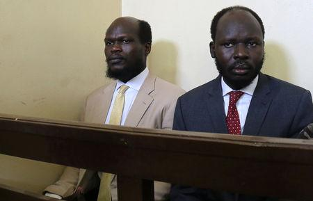 Kerbino Wol, a businessman, and Peter Biar Ajak, the South Sudan country director for the London School of Economics International Growth Centre based in Britain, sit inside the courtroom in Juba, South Sudan March 21, 2019. REUTERS/Stringer