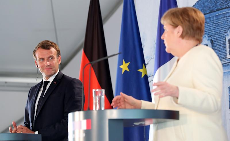 """German Chancellor Angela Merkel and French President Emmanuel Macron give a press conference on June 29, 2020 at the German governmental guest house in Meseberg, outside Berlin. - Chancellor Angela Merkel hosts French President Emmanuel Macron for talks, two days before Germany takes on the rotating presidency of the European Union on July 1, 2020 with an economy mired in the worst crisis since World War II. Berlin's chairing of the 27-member bloc will be the last with Merkel in charge, and could be the one that defines the legacy of the leader dubbed the """"eternal chancellor"""". (Photo by Hayoung JEON / POOL / AFP) (Photo by HAYOUNG JEON/POOL/AFP via Getty Images) (Photo: HAYOUNG JEON via Getty Images)"""