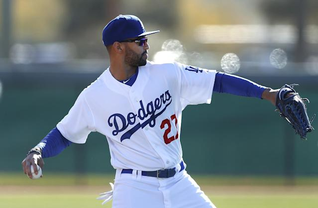 Los Angeles Dodgers center fielder Matt Kemp throws during spring training baseball practice in Glendale, Ariz., Friday, Feb. 14, 2014. (AP Photo/Paul Sancya)