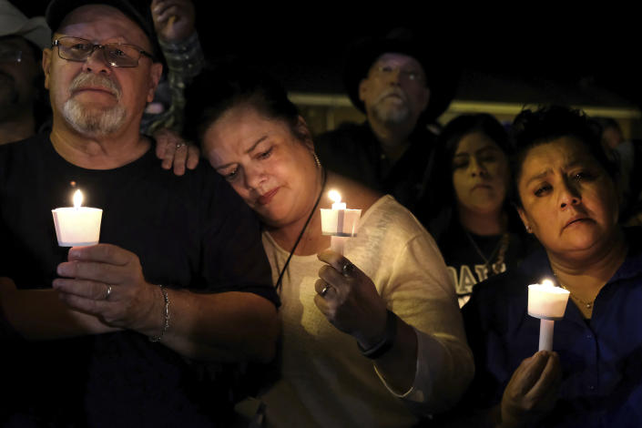 <p>Community members come together for a candlelight vigil for the victims of a deadly church shooting in Sutherland Springs, Texas, Nov. 5, 2017. (Laura Skelding/AP) </p>
