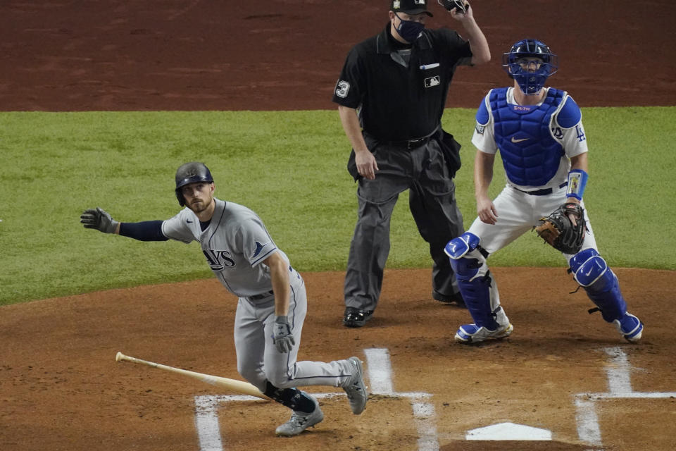 Tampa Bay Rays' Brandon Lowe watches his home run against the Los Angeles Dodgers during the first inning in Game 2 of the baseball World Series Wednesday, Oct. 21, 2020, in Arlington, Texas. (AP Photo/Sue Ogrocki)