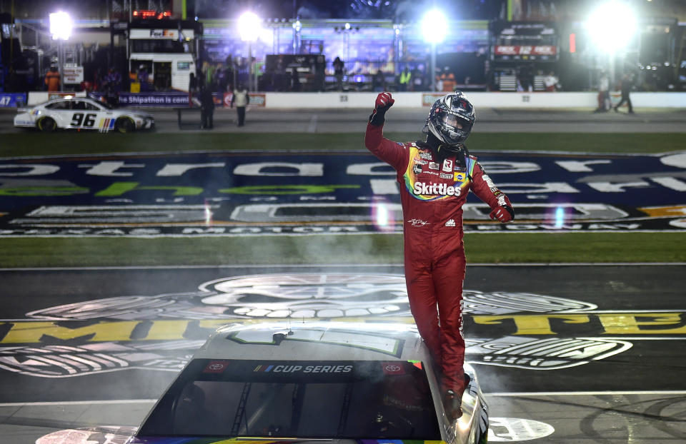 FORT WORTH, TEXAS - OCTOBER 28: Kyle Busch, driver of the #18 Skittles Zombie Toyota, celebrates after winning  the NASCAR Cup Series Autotrader EchoPark Automotive 500 at Texas Motor Speedway on October 28, 2020 in Fort Worth, Texas. (Photo by Jared C. Tilton/Getty Images)