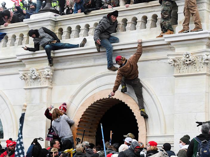 <p>Rioters on the US Capitol on 6 January</p> (REUTERS)
