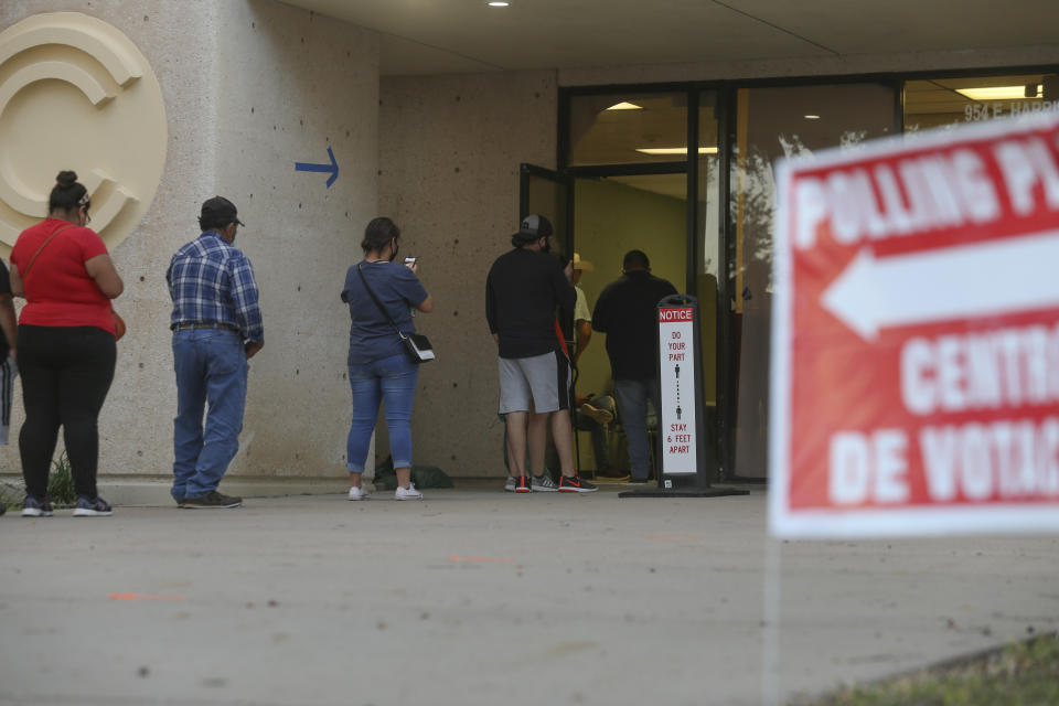 Voters wait to cast ballots