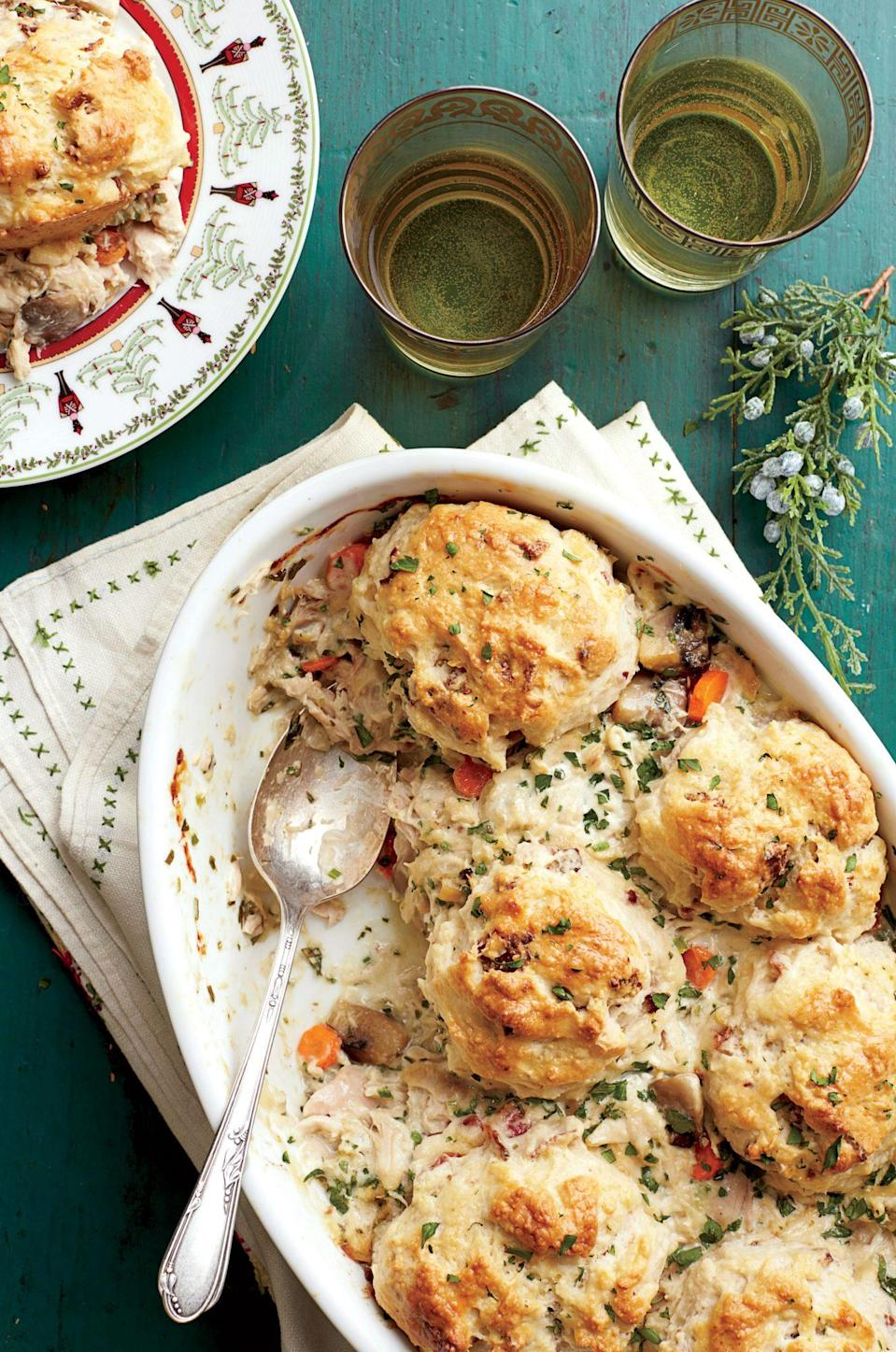 """<p><strong>Recipe: <a href=""""https://www.southernliving.com/recipes/chicken-and-biscuit-cobbler-recipe"""" rel=""""nofollow noopener"""" target=""""_blank"""" data-ylk=""""slk:Chicken-and-Biscuit Cobbler"""" class=""""link rapid-noclick-resp"""">Chicken-and-Biscuit Cobbler</a></strong></p> <p>When you hear """"cobbler,"""" you might think of sweet peach and fresh berry confections in the summertime. This winter, enjoy a different kind of cobbler with this savory casserole topped with fluffy buttermilk biscuits with bacon in them.</p>"""