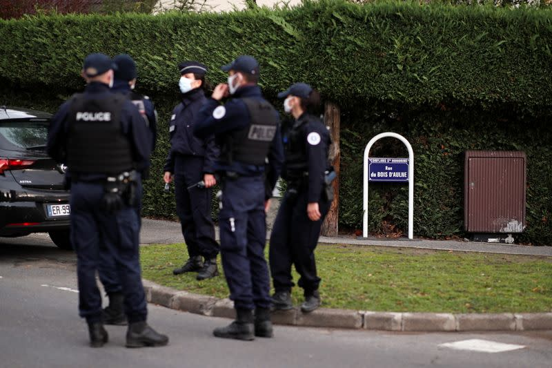 Police officers secure the area around the Bois d'Aulne college in the Paris suburb of Conflans-Sainte-Honorine