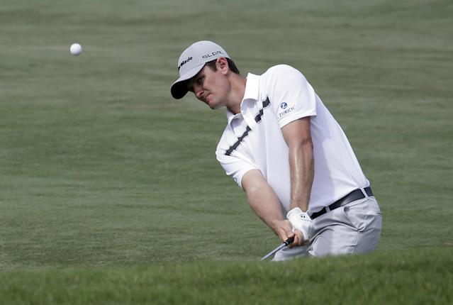 Justin Rose of England, chips from the fairway to the 11th green from during the third round of The Players championship golf tournament at TPC Sawgrass, Saturday, May 10, 2014, in Ponte Vedra Beach, Fla. (AP Photo/John Raoux)