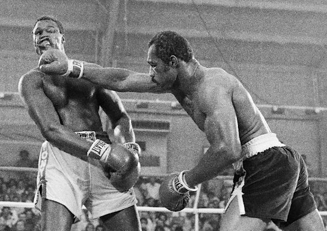 "FILE - In this June 9, 1978, file photo, Ken Norton, left, and Larry Holmes battle for the WBC heavyweight championship at Caesars Palace in Las Vegas. Holmes won the bout in a 15-round split decision. Norton passed away Wednesday, Sept. 18, 2013, at a Las Vegas care facility, his son said. Norton was 70. Norton had been in poor health for the last several years after suffering a series of strokes, a friend of his said. Gene Kilroy, who was Ali's former business manager, says he's sure Norton is ""in heaven now with all the great fighters."" (AP Photo/File) (AP Photo/File)"