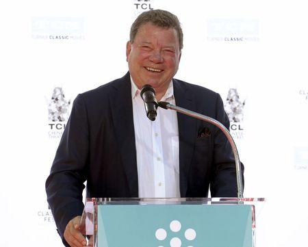 Actor Shatner speaks during a handprint and footprint ceremony honoring actor Plummer at the TCL Chinese Theatre in Los Angeles