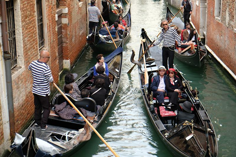VENICE, ITALY - MAY 21, 2019: Gondolas full of foreign tourists move in a small canal on May 21, 2019 in Venice, Italy. (Photo by Kaveh Kazemi/Getty Images)