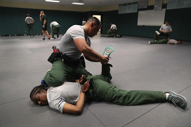 <p>New U.S. Border Patrol agents practice take-down procedures at the Border Patrol Academy on August 2, 2017 in Artesia, N.M. (Photo: John Moore/Getty Images) </p>