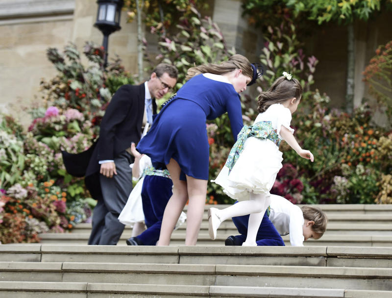 Some of the tiniest members of the wedding were no match for the heavy winds: page boy Louis de Givenchy fell over on the steps, but got right back up again.