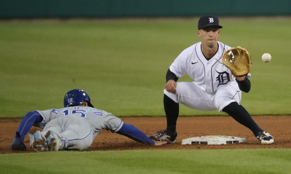 Tigers second baseman Zack Short holds Royals right fielder Whit Merrifield at second base during the Tigers' 6-2 loss to the Royals on Friday, April 23, 2021, at Comerica Park.