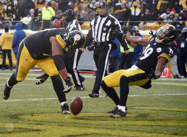 <p>Pittsburgh Steelers offensive guard Ramon Foster (73) spikes the ball as he celebrates a rushing touchdown my Steelers Pittsburgh Steelers running back Stevan Ridley with wide receiver JuJu Smith-Schuster (19)during the first half of an NFL football game against the Cleveland Browns in Pittsburgh, Sunday, Dec. 31, 2017. (AP Photo/Don Wright) </p>