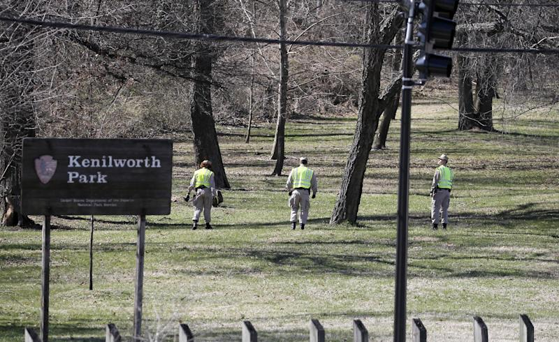 Washington Metro Police and cadets search in Kenilworth Park in Washington, Monday, March 31, 2014. Police have been searching the park in northeast Washington since last week for clues in the case of eight-year-old Relisha Rudd, last seen in the company of Kahlil Tatum, a janitor at the homeless shelter where she lived with her mother and brothers.(AP Photo/Alex Brandon)