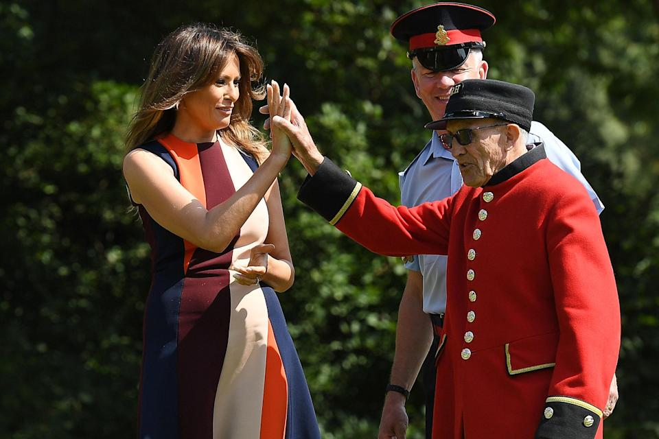 Melania Trump, pictured high-fiving a Chelsea Pensioner. [Photo: Getty]