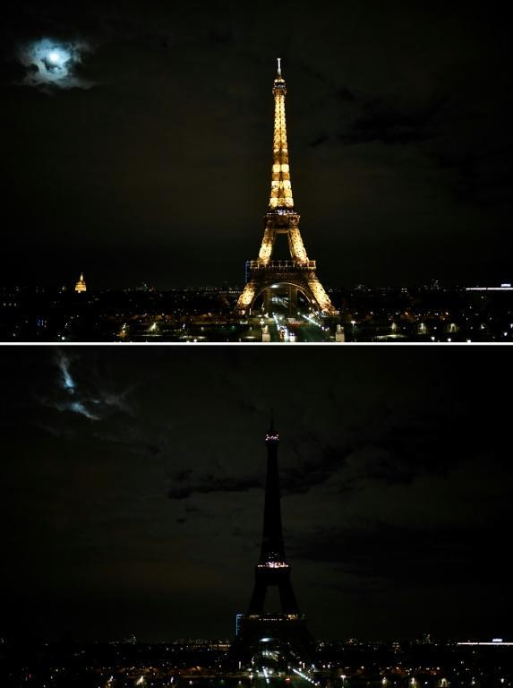 In Paris, the three stages of the Eiffel Tower progressively went dark but there were few people to watch with the whole country under a 7 pm Covid-19 curfew