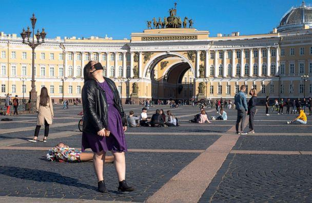 PHOTO: People relax outside in warm weather at the Palace Square in Saint Petersburg, Russia, on May 24, 2020, despite the self-isolation regime announced by Russian authorities due to the coronavirus pandemic. (Dmitri Lovetsky/AP)