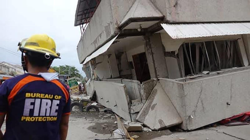 Rescuers check a collapsed building following an earthquake that struck Padada, Davao del Sur province, southern Philippines on Sunday Dec. 15, 2019. A strong quake jolted the southern Philippines on Sunday, causing a three-story building to collapse and prompting people to rush out of shopping malls, houses and other buildings in panic, officials said. (AP Photo)