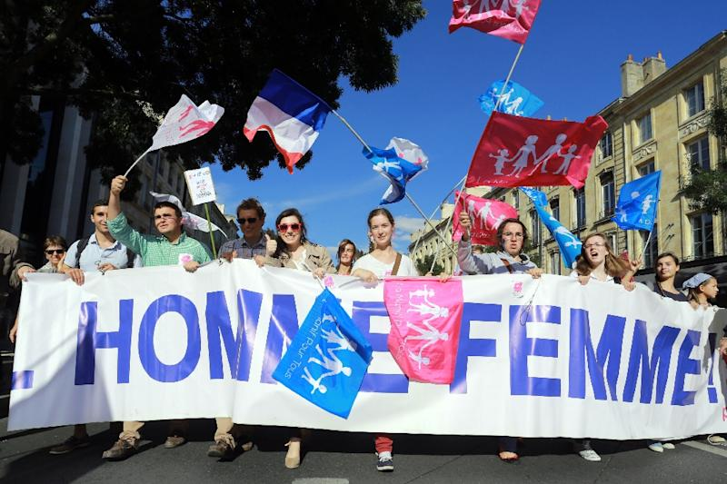 "Supporters of the anti-gay marriage ""La Manif Pour Tous"" (Protest for Everyone) movement march against medically assisted procreation techniques for lesbian couples and surrogacy, in Bordeaux, France on October 5, 2014 (AFP Photo/Nicolas Tucat)"