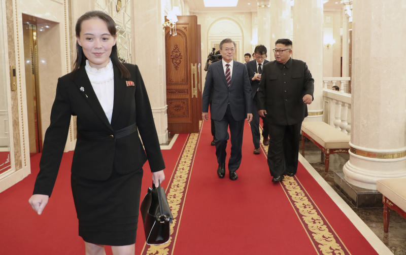 FILE - In this Sept. 18, 2018, file photo, Kim Yo Jong, left, sister of North Korean Leader, walks ahead of South Korean President Moon Jae-in and North Koran leader Kim Jong Un, right, arrive at the headquarters of the Central Committee of the Workers' Party in Pyongyang, North Korea. In her first known official statement Tuesday, March 3, 2020, Kim's younger sister leveled diatribes and insults against rival South Korea for protesting her country's latest live-fire exercises.(Pyongyang Press Corps Pool via AP, File)