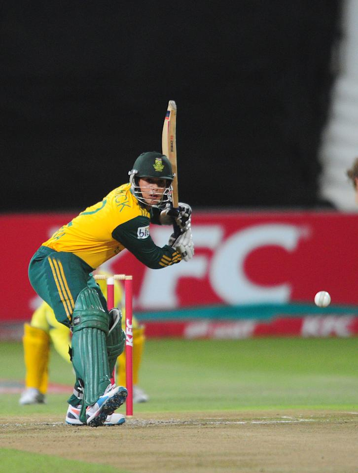 In this photo taken Wednesday, March 12, 2014, South Africa's Quinton de Kock plays at the wicket during their rain-delayed T20 cricket match against Australia in Durban, South Africa. (AP Photo)