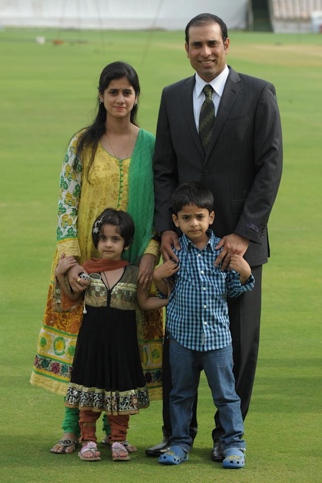 Indian cricketer Vangipurappu Venkata Sai (VVS) Laxman (top R), wife Sailaja with children Sarvajith and Achinthya, pose for a photograph before a press conference held to announce his retirement from Test Cricket at the Rajiv Gandhi International cricket stadium in Hyderabad on August 18, 2012. Veteran Indian batsman Vangipurappu Venkata Sai Laxman announced his retirement from international cricket on Saturday, saying it was time to make way for the next generation.   AFP PHOTO / Noah SEELAM