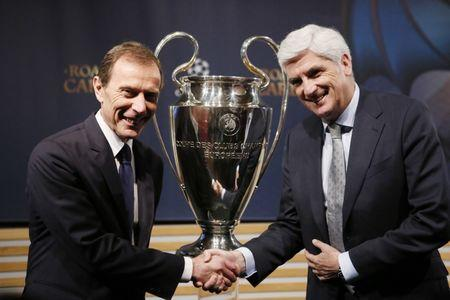 Real Madrid Director of Institutional Relations Emilio Butragueno (L) and Atletico Madrid Managing Director Clemente Villaverde pose after the draw of the UEFA Champions League semi-finals