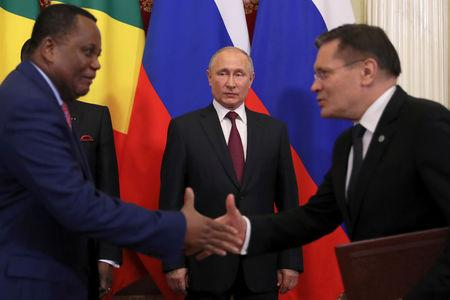 FILE PHOTO: Russian President Vladimir Putin (C) attends a signing ceremony following talks with President of Congo Republic Denis Sassou Nguesso (L) at the Kremlin in Moscow, Russia May 23, 2019. REUTERS/Evgenia Novozhenina/File Photo